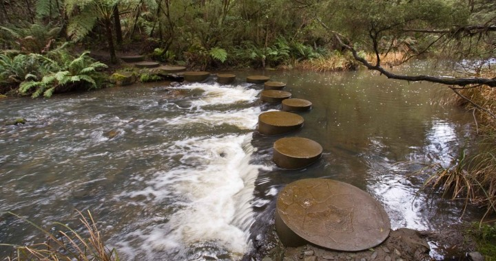 stepping stones across turbulent waters representing seven steps to telling difficult truths